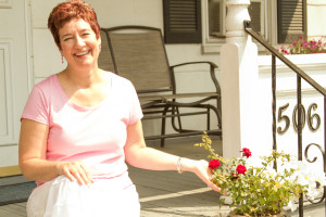 Renee Takacs Intuitive Consultant sitting on porch